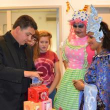 North West Magician Darren Brand performing for Cbeebies TV presenter Nisha Anil